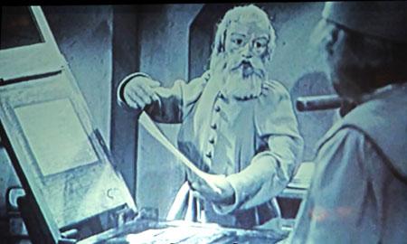 Druckvorführungs-Szene aus dem 2012 durch einen modernen Animationsfilm abgelösten Puppenfilm der Gebrüder  Hermann und Ferdinand Diehl.